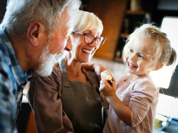 Grandparents playing with their young grandaughter